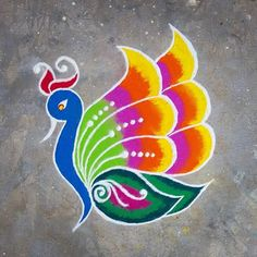 Latest Peacock Rangoli designs for Diwali they use blue, green, red, yellow and purple color to make this beautiful rangoli and highlight this rangoli with white colors Easy Rangoli Patterns, Rangoli Designs Peacock, Easy Rangoli Designs Diwali, Rangoli Simple, Indian Rangoli Designs, Simple Rangoli Designs Images, Rangoli Designs Latest, Rangoli Border Designs, Small Rangoli Design