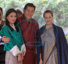 Bhutan's King Jigme Khesar Namgyel Wangchuck (C, front) and Queen Jetsun Pema Wangchuck (L, front) pose for photos with Indian Congress Party president Sonia Gandhi