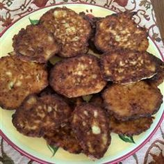 Mom's Zucchini Pancakes Allrecipes.com add garlic powder, seasoned salt and pepper. Squeeze water out of zucchini. Use grated onion to mix in with patty, omit green onion