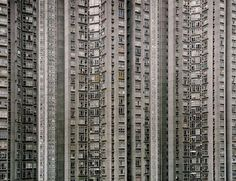 Hong Kong is one of the first cities people think of when they think cyberpunk, and with good reason. A staple of cyberpunk is big cities, lots of people, high population density, and technology… Hong Kong Architecture, Architecture Art, Lombok, Michael Wolf, Ligne D Horizon, World Press Photo, Ghost City, Wolf Photography, Sense Of Place