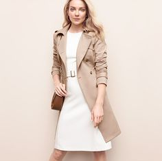 Layer with sophistication in a belted sheath and streamlined trench. #whbm