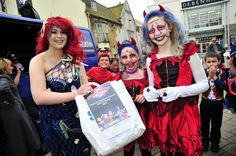 Freaky Friday in Weymouth town centre on 30th October 2015.   Fancy Dress competition winners presented their prize by Elysia Munday in New Bond Street.  Picture: Graham Hunt.