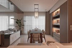The kitchen and dining area, while minimalist in style and completely functional, also have a touch of whimsy, as evidenced by the storage lighting, soft window treatments along the wall, and touches of luxurious marble as a divider to the two rooms.
