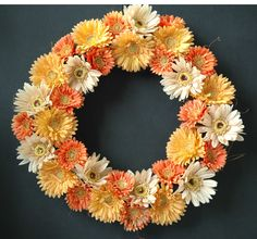 Gerber Daisies in peach, beige, and yellow.