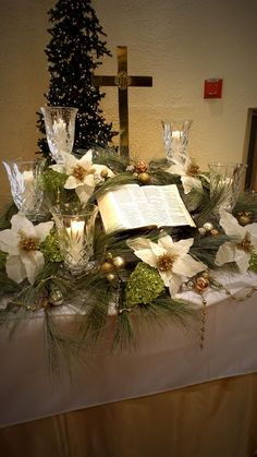This Christmas altar would not be complete without an open Bible revealing the Christmas Story and the image of the Cross. Lead crystal candle holders and handmade poinsettias add a touch of elegance to our Christmas Setting. Check out Party with Pizzazz on Facebook for more pictures.