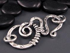 textured clasp-wrapping with a heavier duty wire makes a big difference in the appearance, much nicer for many applications