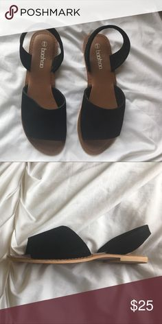 Cute black faux suede sandal These sandals have a large over the toe piece that allows a little peek trough of your toes while still being very comfortable!  The back strap helps with fit and is very comfortable as well.  Unworn. Boohoo Shoes Sandals