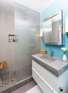 A Futuristic Bathroom With Silver And Blue Wall With Shiny White Cabinet With Glossy Mirror And Astounding Glass Showering Room With Unique Tile Floor Setting Up your Bathroom 3/4 m Efficiently and Conveniently