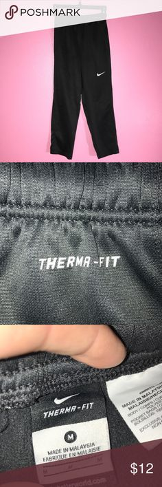 Boys Nike Therma-Fit Pants Boys Nike pants in next to new condition. Dark charcoal grey/black. Signature swoosh at knee. Size M. Items less than $5 must be bundled. Prices are always negotiable, especially with the purchase of multiple items. Same day shipping when possible. Please excuse any of my wrinkles. CHECK OUT ALL MY OTHER LISTINGS TOO- LOTS OF GREAT THINGS!!! Nike Bottoms