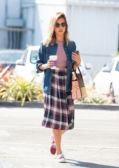Jessica Alba in a plaid skirt, striped crop top, and sneakers
