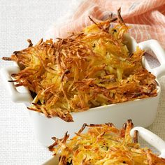 Succulent fish and seafood become a decadent dinner when mixed into a creamy sauce topped with a crispy, shredded potato crust. Get the recipe.  - WomansDay.com