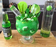 APPLE CIROC CANDY BOWL 3 oz (90ml) Ciroc Apple 1 oz (30ml) Blue Curacao 4 oz (120ml) Mango Nectar 1 oz (30ml) Green Apple Soda Ice Blend GARNISH: 2 Mini Apple Ciroc Bottles Green Apple Rings Green Apple Lolipops Green Gummy Bears Frog Gummies Green Jelly Beans Sour Apple Candies Green Rock Candies Green Licorice Sticks