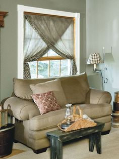 Create this no-sew window treatment in no time: Cut a piece of woven fabric, such as homespun or muslin, to double the desired curtain length. Drape the fabric over a curtain rod and adjust so the ends are even. Pin the fabric together at each end of the rod, place the rod in the window, and tie back one layer of the fabric to either side of the window.