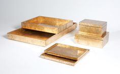Studio A's luxurious lacquered collection of gold-leafed boxes and trays. Studioa-home.com