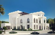 White Modern Islamic villa exterior design 8- Modern windows on the ground floor along with pointed arched ones on the first floor seamlessly create the modern Islamic villa exterior design style by Comelite Architecture Structure and Interior Design, white stone with geometric patterns covering the exterior façade, double height horseshoe arches distinguish the villa entrances, reflecting the hospitality of the Arabian culture.