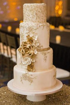The Chic Technique:  Gold and white wedding cake. #GlitterCake