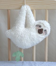 Musical soft toy sloth