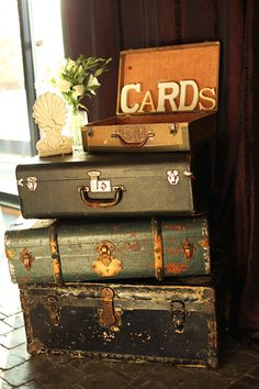 stack 2 on the table and have a hole in bottom of top one to feed cards into bottom suitcase