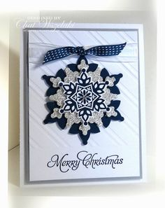 Stampin' Up! ... handmade Christmas card ... white and navy blue ... diagonal stripe embossing folder texture ... layered die die cut snowflake with silver glimmer paper for middle layer ... could be a detachable ornament ... luv it!
