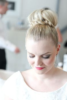 Top knot wrapped with a pretty little braid
