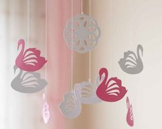 This swan nursery mobile features eight pink and white swans and an ornament in the middle of the nursery decor. These swans are NOT made of PAPER. In fact, I made this baby mobile with an amazing anti-allergenic and bpa free foam-like material. Buy the mobile without hesitation. All