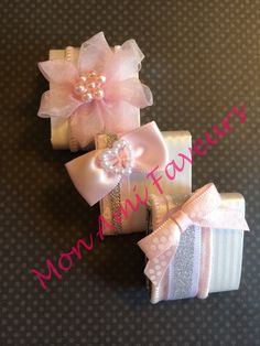 Adorable pink and silver wrapped chocolate favors to welcome your little cutie.