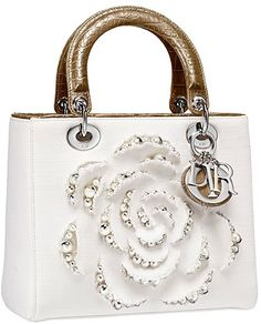 White designer handbag with silver tipped rosette and leather handles -- beautiful for summer