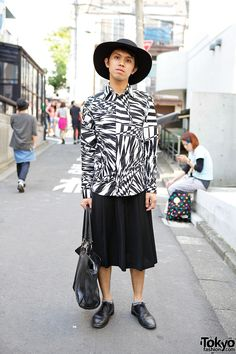 Tokyo-based fashion blogger Gervin on the street in Harajuku wearing a Versace for H&M shirt with a hat and Zara oxfords. Always a pleasure to run into Gervin!