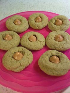 "Pumpkin Blossom Cookies...like Peanut Blossoms but with a pumpkin cookie base and pumpkin spice Hershey Kiss. Easy to make...use Pilsbury Pumpkin Cookie Mix, prepare according to package directions. Form into 1"" balls and roll in granulated sugar. Bake according to package directions. Remove from oven and place a pumpkin spice Hershey kiss in the center of each one. A pumpkin lover's dream."