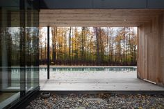 A covered breezeway frames a view of the pool. The residents use the home during summer and winter equally.
