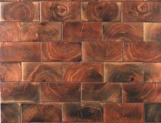 end grain flooring. It looks so cool. installed like tiles.
