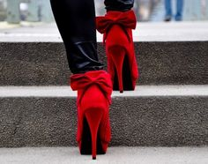 Flashy-red stilettos with a bow to top it off!!