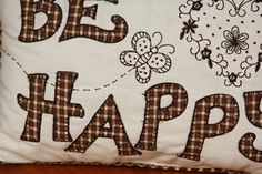 """BE HAPPY"" cushion - embroidered and appliquéd detailing in beige and chocolate browns – x Chocolate Brown, Cushions, Throw Pillows, Beige, Happy, Toss Pillows, Toss Pillows, Pillows, Decorative Pillows"