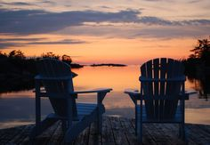Muskoka chairs on a dock overlooking a lake and a gorgeous sunset Beautiful Sunset, Beautiful Places, Haus Am See, Lakeside Living, Lake Cabins, Chula, Hans Christian, Peaceful Places, Cottage Living