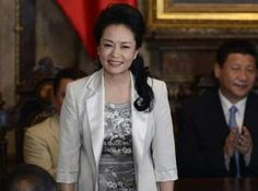 China's glamorous and independently famous First Lady Peng Liyuan often commands more intense human interest among Chinese than her husband Xi Jinping.
