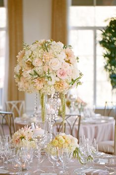Adore this centerpiece idea. Elevated plus, low centerpieces with votives | Photo by Lane Dittoe