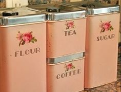 Some cute things i bought at a garage sale | vintage flour, ta, coffee and sugar canister retro metal set in peach color and rose print #garagesale #vintagehomedecor