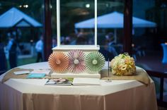 Love this table decor on the guest book table!  Photo by @jadenorwood