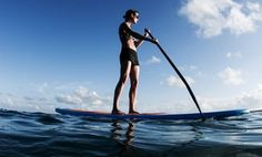 Groupon - Surfing or Standup Paddleboarding Lesson for One or Two at Clint Carroll Surf School in Newport Beach. Groupon deal price: $49