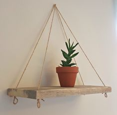 Handmade reclaimed pallet wood rustic shelves | wall hanger | wall display | shabby chic | twine shelves | twine shelving. Shelves can be hung in many different ways - against the wall as a pyramid as shown/ or with string straight. Also from the ceiling.  The shelves are a perfect size suitable for any room of the home, office etc. Perfect for displaying plants, candles, pictures, ornaments, rolled towels, toiletries, kitchenware etc.