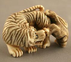 Ivory Netsuke Depicting a Tiger Chasing a Rabbit