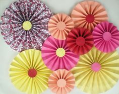 Hey, I found this really awesome Etsy listing at https://www.etsy.com/listing/181609192/paper-rosettes-pink-yellow-coral-red