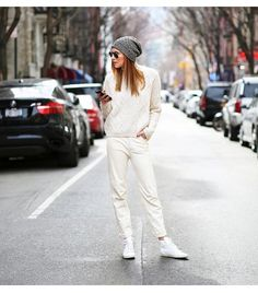 Add texture to your head-to-toe white look with a cable knit sweater like Danielle Bernstein of We Wore What. ​On Bernstein: Topshop sweater, J Brand pants, Saint Laurent sneakers.