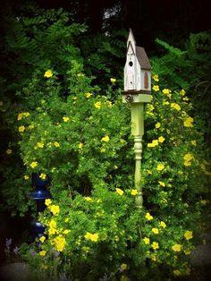 Make a Flea Market bird house post A rose climbs Kirk Willis's porch post