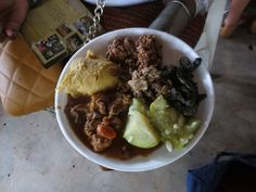 Spectrum of Traditional Botswana's Food: Plate laden with bogobe jwa lerotse (sorghum with melon), seswaa (pounded goat meat), beef stew, makgomane (a kind of local squash), mophane worms, dinawa (beans), madombe (steamed dumplings), setampa (maize kernels) and lephutshi (butternut squash).