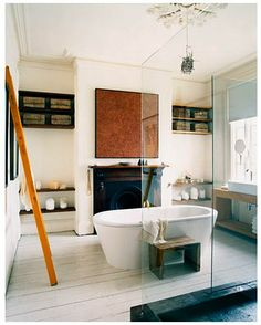 Like the warm neutrals with the white and the free standing tub.