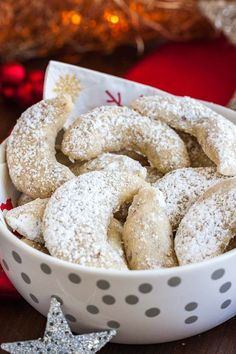 Vanillekipferl (German Vanilla Crescent Cookies) are traditional German Christmas Cookies made with ground nuts and dusted with vanilla sugar! They are tender, nutty and melt in your mouth. A perfect cookie to make ahead that's always a hit. Spritz Cookies, Vanilla Cookies, Almond Cookies, Vanilla Sugar, German Christmas Cookies, German Cookies, Xmas Cookies, Holiday Baking, Christmas Baking