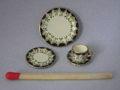 A little hand-painted dollshouse set comprising of a tea cup & saucer and a tea plate. Painted by myself on British made metal miniatures. The tea cup measures 7mm high. The tea plate is 1.5cm in diameter and the larger plate is 2cm in diameter. These are collectors items and are not suitable for children.