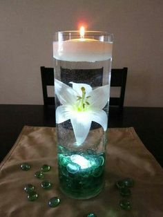 White flower floating candle centerpiece