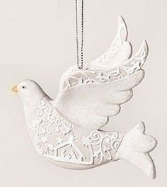 "5"" Dove Ornament papercut look made of resin."